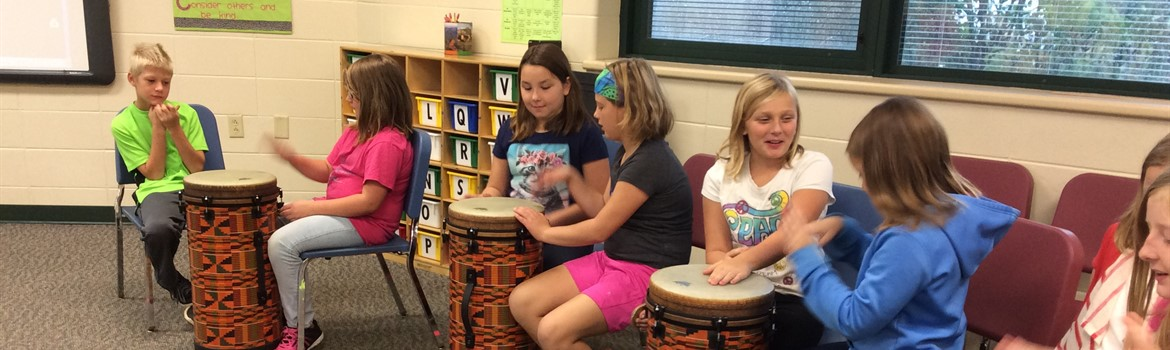 Drumming in music class.