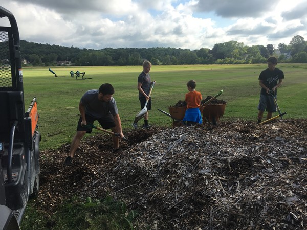 KHS Football students haul wood chips for school garden