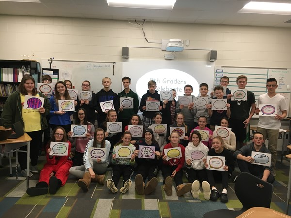 8th graders celebrate how they have grown as writers after finishing their theme analysis essays!